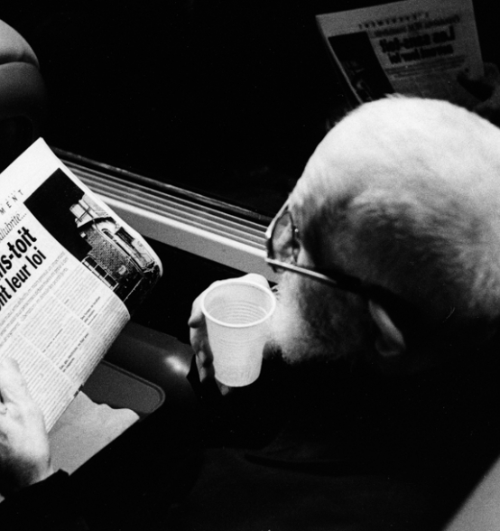 Abbé Pierre reads a newspaper which the law against exclusion